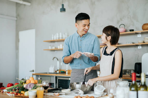 Affectionate young asian couple preparing cookies together in a picture id1158130382?b=1&k=6&m=1158130382&s=612x612&w=0&h=slwqdq02ldl7kxfavddedir2lh0mikmfs5ig5mpf4su=