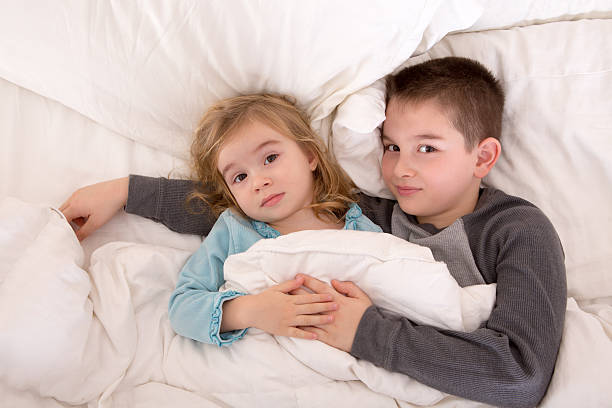 Royalty Free Little Brother And Sister Waking Up Pictures
