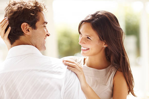 Affectionate young couple looking at each other stock photo