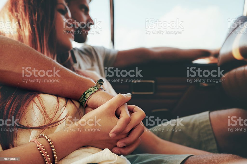 Affectionate young couple on a road trip stock photo