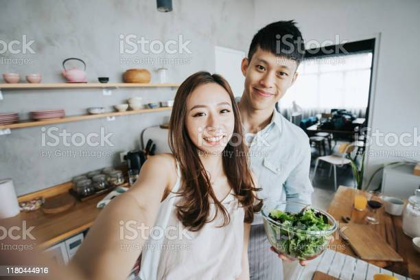Affectionate young smiling asian couple taking a selfie with while picture id1180444916?b=1&k=6&m=1180444916&s=612x612&h=zpa0667zchb4sdq3akzpduwmksmecoq1sqpjsotscxg=