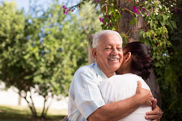 Affective senior couple Affective senior couple embracing each other in a park affective stock pictures, royalty-free photos & images