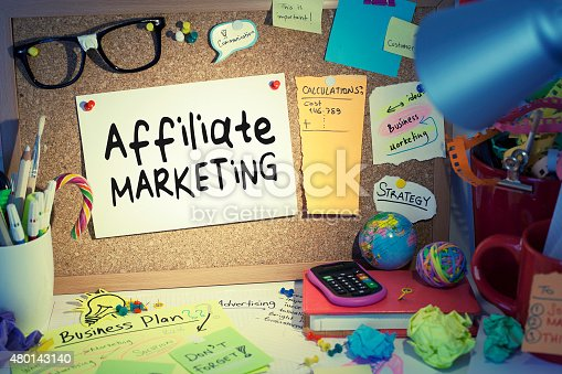 Affiliate marketing concept business background, paper pinned on cork bulletin board in office.
