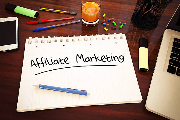 Affiliate Marketing Affiliate Marketing - handwritten text in a notebook on a desk - 3d render illustration. affiliate stock pictures, royalty-free photos & images