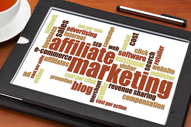 affiliate marketing word cloud affiliate marketing word cloud on a digital tablet with a cup of tea affiliate stock pictures, royalty-free photos & images