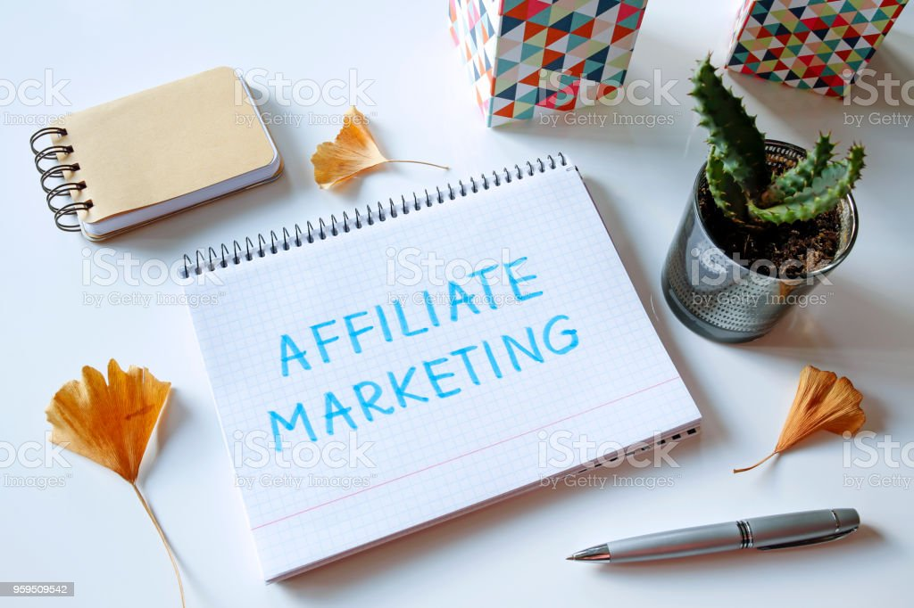 affiliate marketing written in notebook stock photo