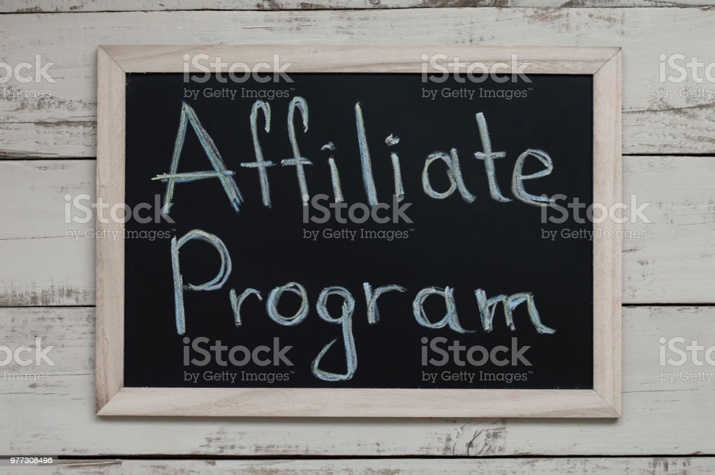 Affiliate Program concept. Affiliate marketing. Blackboard with handwritten text, top view stock photo