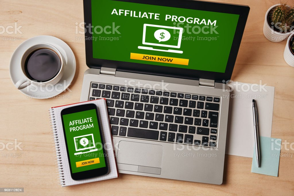 Affiliate program concept on laptop and smartphone screen stock photo