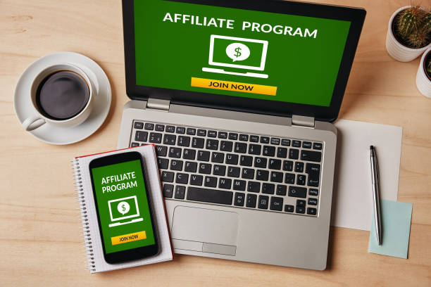 Affiliate program concept on laptop and smartphone screen Affiliate program concept on laptop and smartphone screen over wooden table. All screen content is designed by me. Flat lay affiliate stock pictures, royalty-free photos & images