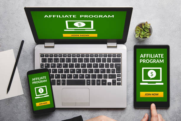 Affiliate program concept on laptop, tablet and smartphone screen Affiliate program concept on laptop, tablet and smartphone screen over gray table. All screen content is designed by me. Flat lay affiliate stock pictures, royalty-free photos & images