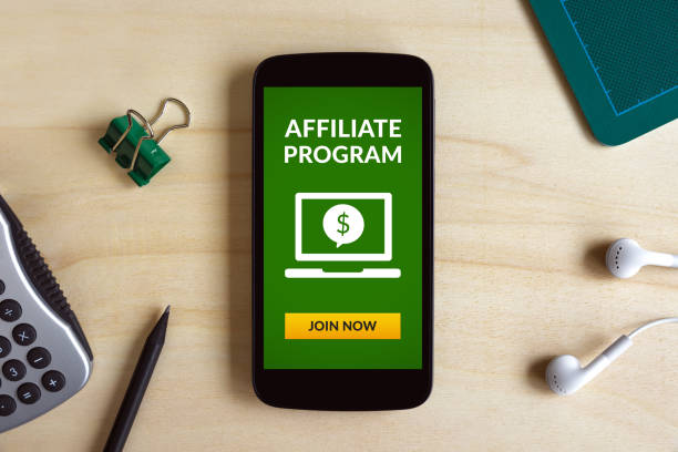 Affiliate program concept on smart phone screen on wooden desk Affiliate program concept on smart phone screen on wooden desk. All screen content is designed by me. Flat lay affiliate stock pictures, royalty-free photos & images