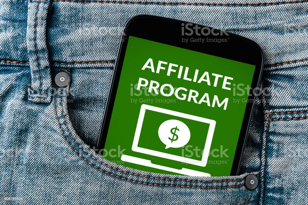 Affiliate program concept on smartphone screen in jeans pocket stock photo