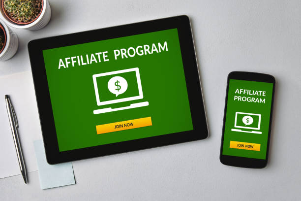 Affiliate program concept on tablet and smartphone screen Affiliate program concept on tablet and smartphone screen over gray table. All screen content is designed by me. Flat lay affiliate stock pictures, royalty-free photos & images