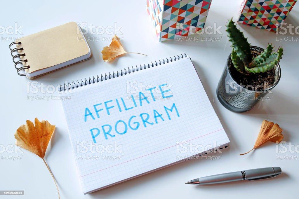 affiliate program written in notebook stock photo