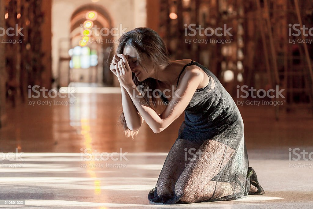 Afflicted woman portrait in a cemetery stock photo