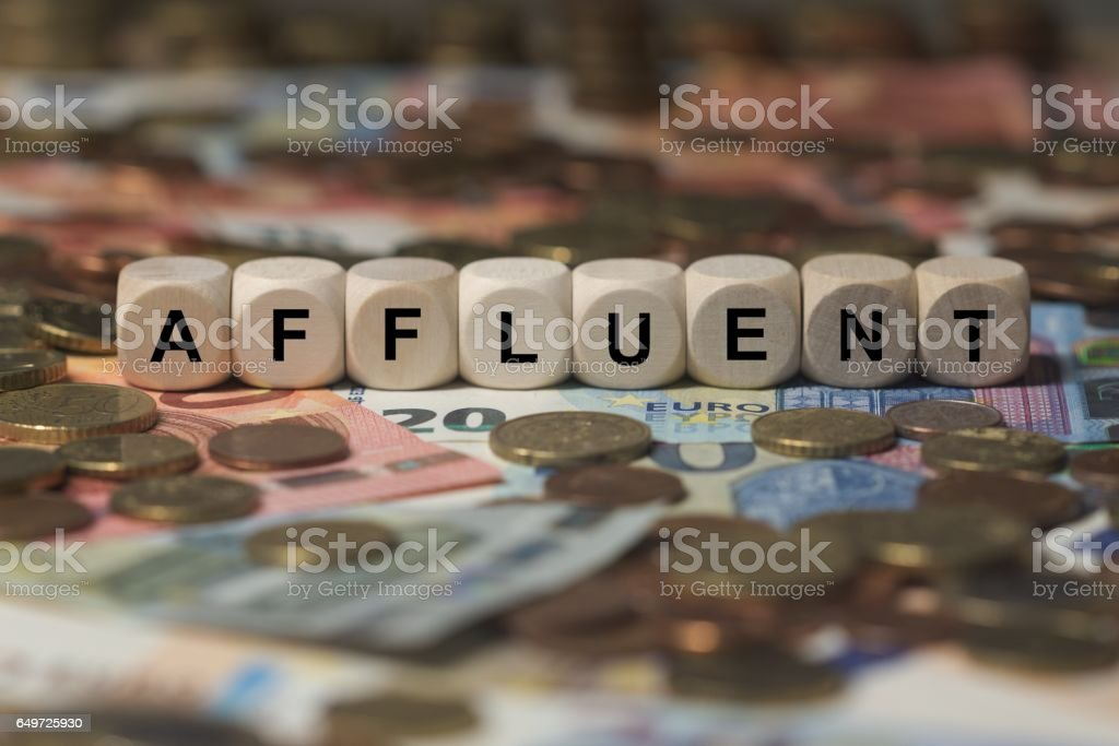 affluent - cube with letters, money sector terms - sign with wooden cubes stock photo