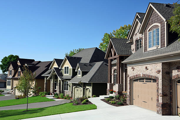 Affluent Suburban Street Perfectly manicured suburban street on a beautiful clear September day. gated community stock pictures, royalty-free photos & images