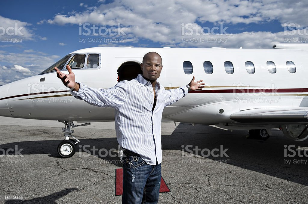 Affluent Travel - African American Man by Private Jet royalty-free stock photo