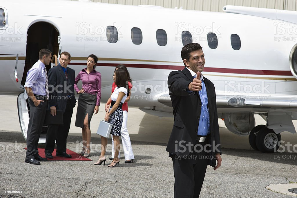 Affluent Travel - Businessman giving thumbs up royalty-free stock photo