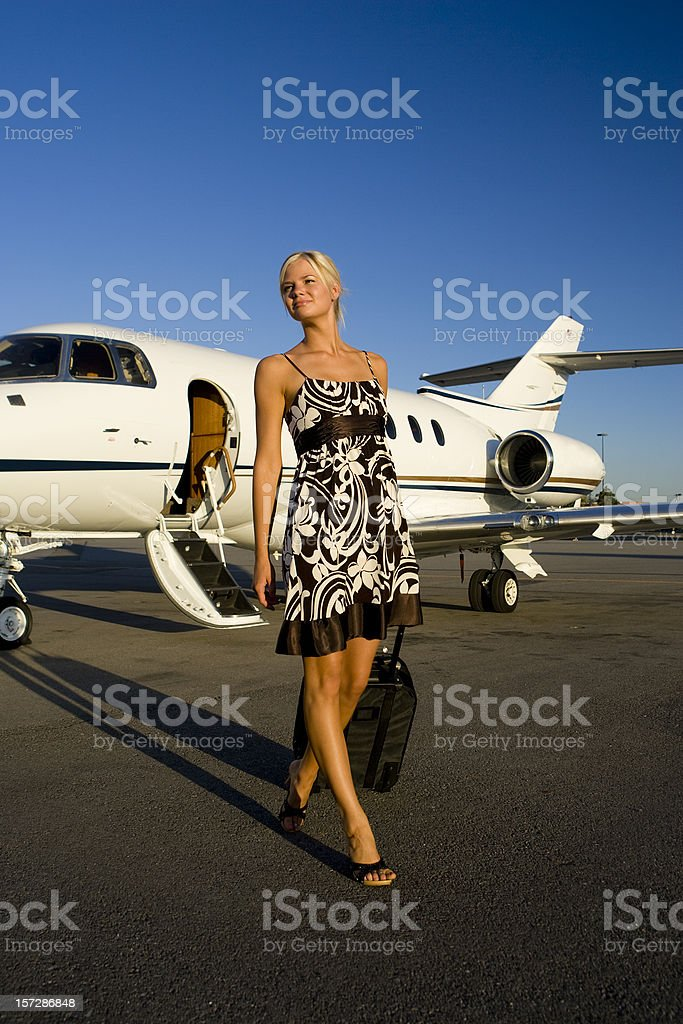 Affluent Travel-Beautiful Woman Arriving at Airport stock photo