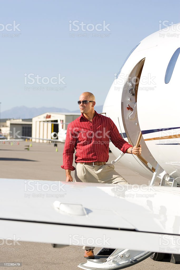 Affluent Travel-Businessman Boarding Airplane stock photo