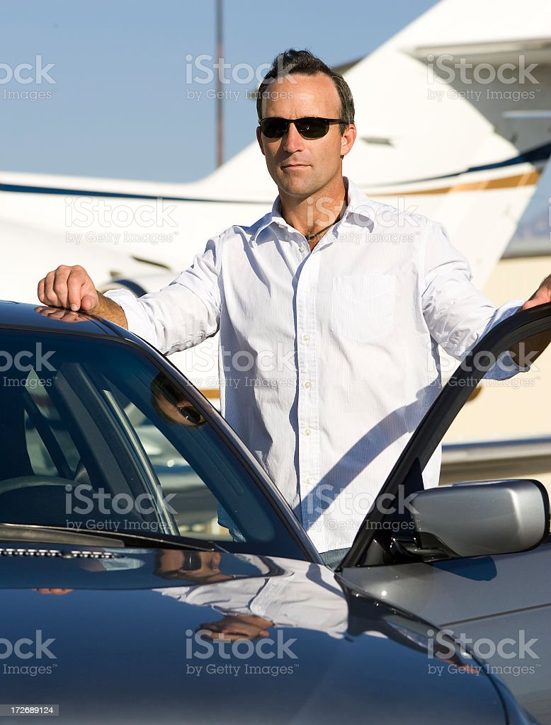 Affluent Travel-Businessman by Car at Airport stock photo