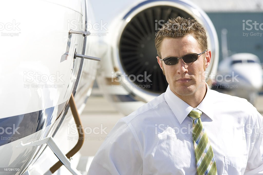 Affluent Travel-Businessman by Private Jet stock photo