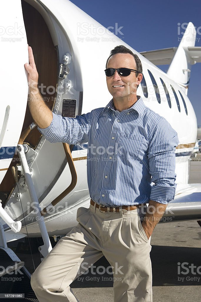 Affluent Travel-Casual Businessman by Private Jet stock photo
