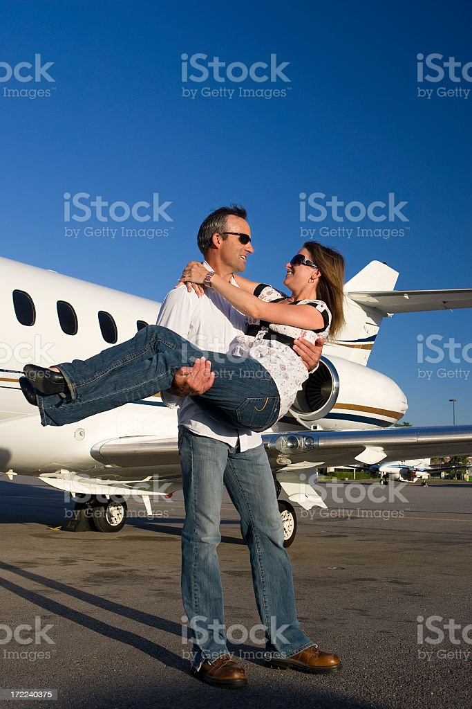 Affluent Travel-Happy Couple at Airport stock photo