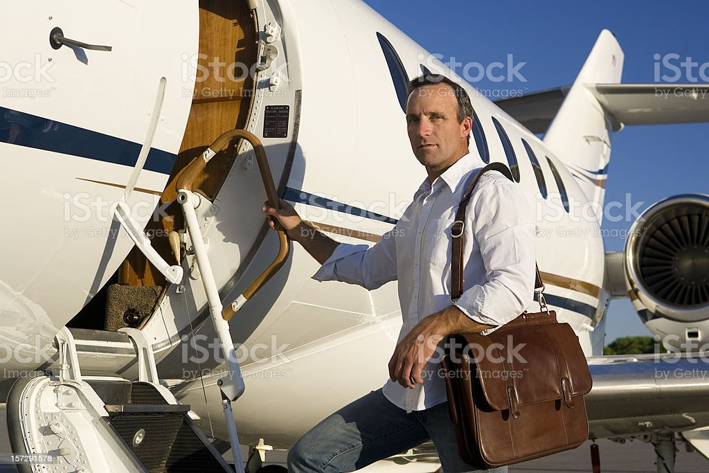 Affluent Travel-Man Boarding Private Jet stock photo