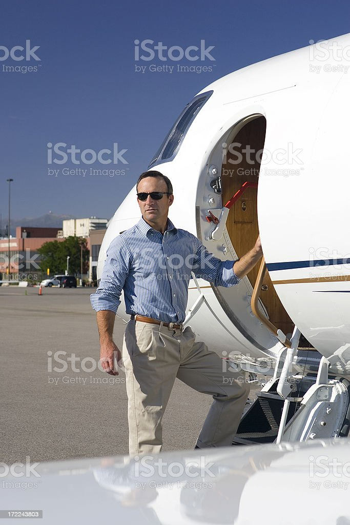 Affluent Travel-Man Boarding Private Jet royalty-free stock photo