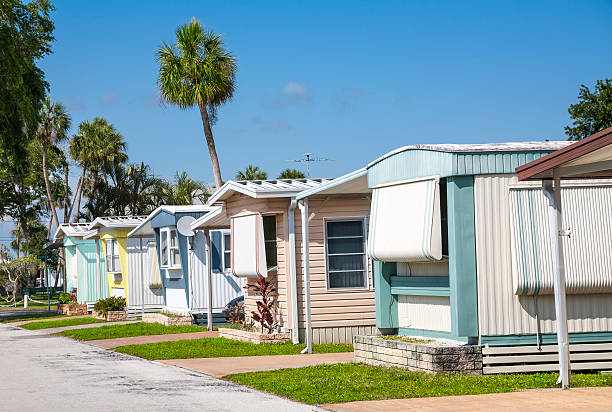Affordable Mobile Homes Modest mobile home community in the tropics. Affordable housing. trailer park stock pictures, royalty-free photos & images