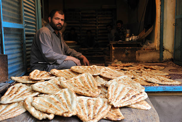 Afghan bread seller, Kabul's market / bazaar stock photo