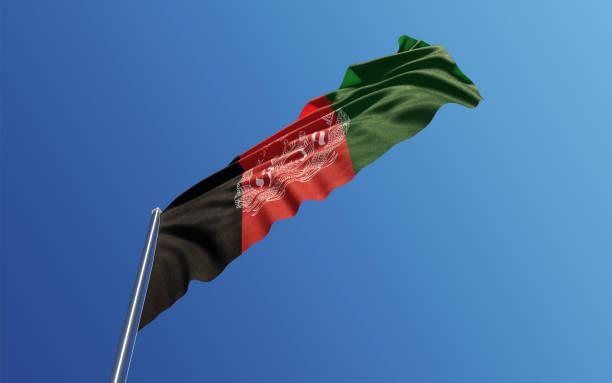 Afghani Flag Waving With Wind On Blue Sky stock photo