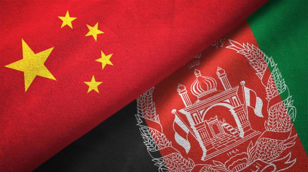 Afeganistão e China duas bandeiras realations juntos têxtil pano tecido textura - foto de acervo
