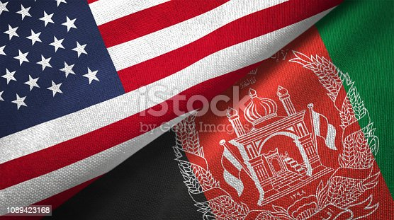 istock Afghanistan and United States two flags together realations textile cloth fabric texture 1089423168