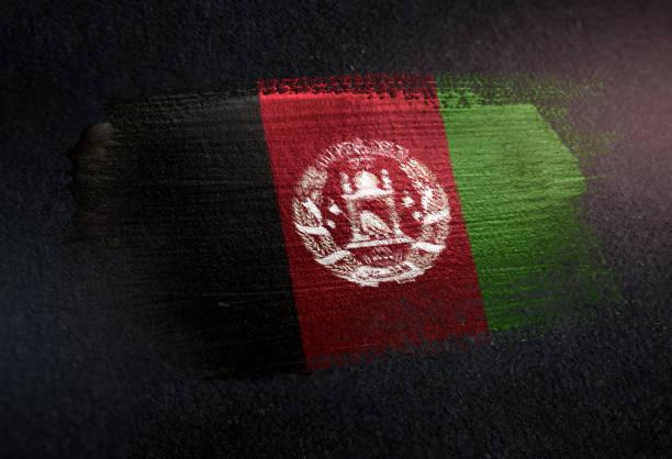 Afghanistan Flag Made of Metallic Brush Paint on Grunge Dark Wall stock photo