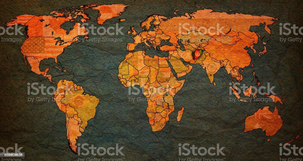 afghanistan flag on old vintage world map stock photo