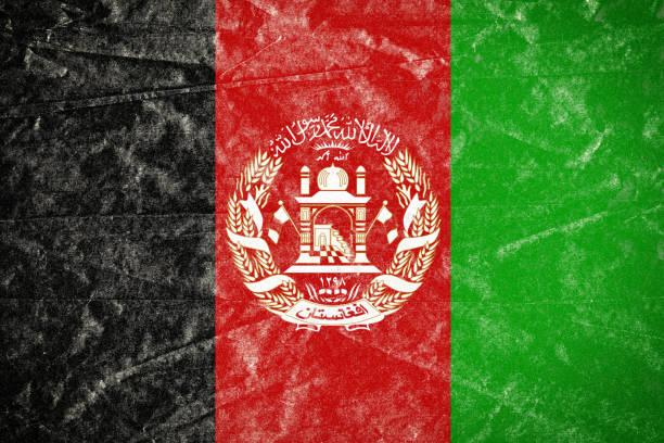 Bandeira do Afeganistão Grunge desintegrado enrugado papel cartaz - foto de acervo