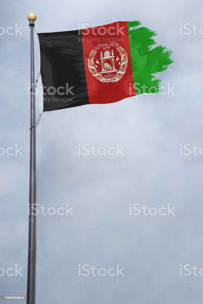 Afghanistan Flag tattered and torn and blowing in the wind stock photo