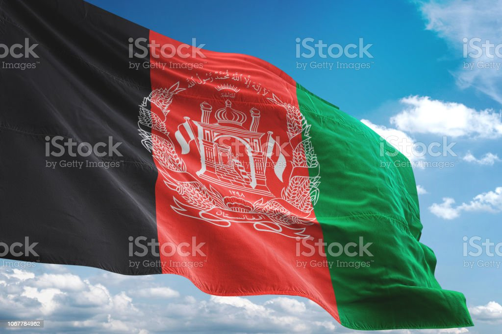 Afghanistan flag waving isolated cloudy sky background stock photo