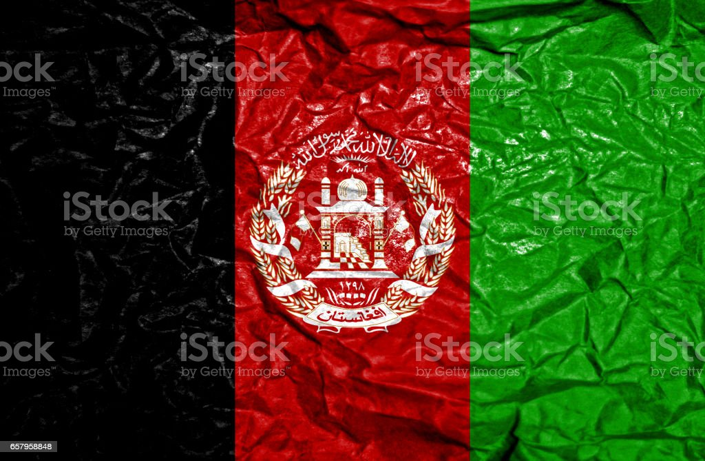 Afghanistan vintage flag on old crumpled paper background stock photo
