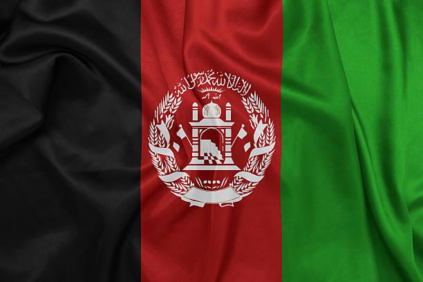 Afeganistão-acenando a bandeira nacional na textura de seda - foto de acervo