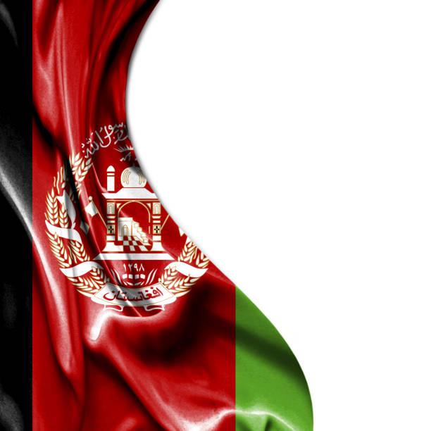 Afeganistão, acenando uma bandeira de cetim isolada no fundo branco - foto de acervo