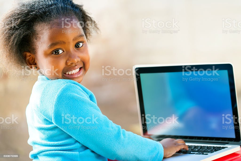 Afican child learning on computer stock photo