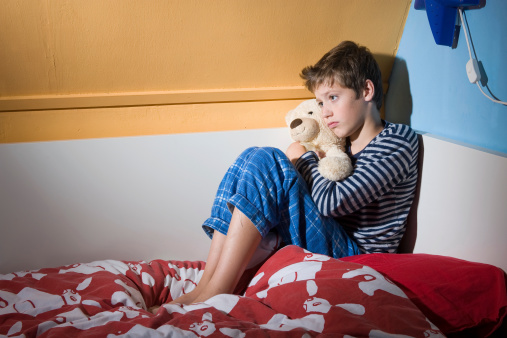 Afraid And Depressed Young Boy Stock Photo - Download Image Now