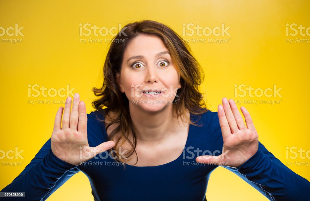 afraid, annoyed displeased young woman raising hands up to say no stock photo