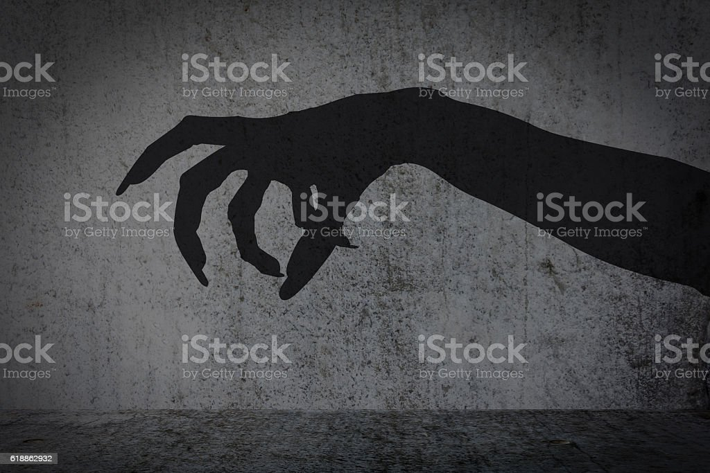 afraid of a big monster claw shadow stock photo