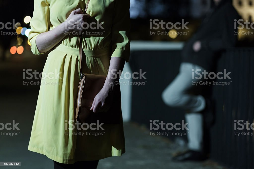 Afraid woman walking alone stock photo