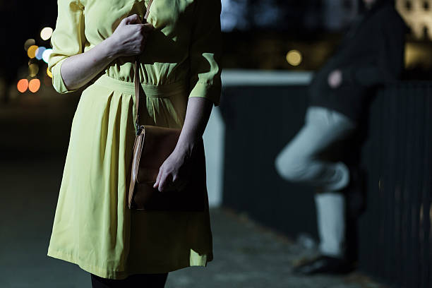 afraid woman walking alone - stalking stock photos and pictures